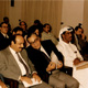 Khaldoun attending a symposium with a friend